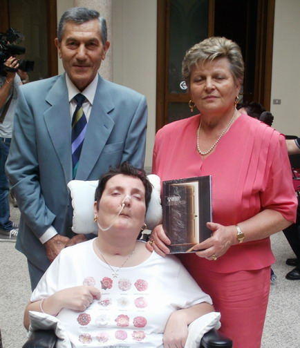 30 giugno 2011. Milano. Presentazione del libro ' Il Sorriso di Moira'. La famiglia Quaresmini: Moira babbo e mamma